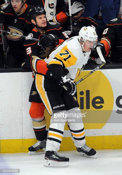 Bieksa shoved by Malkin as going for change.jpg